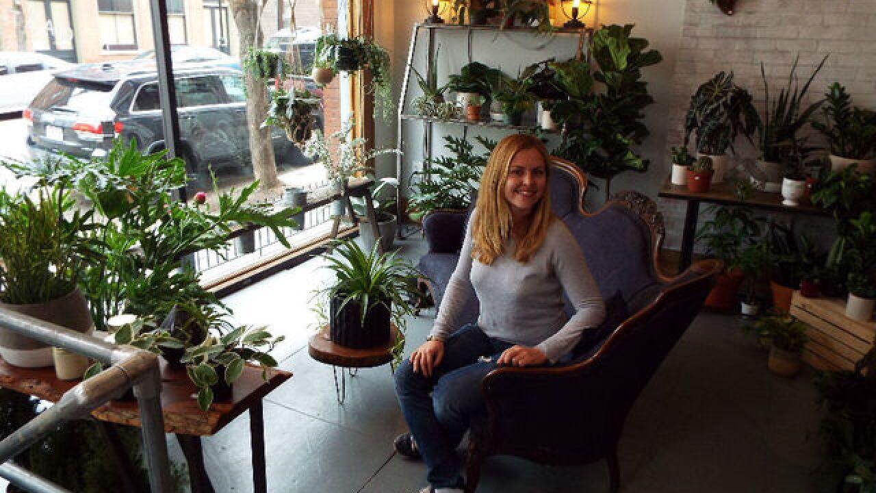 New business owner nurtures tiny flower shop