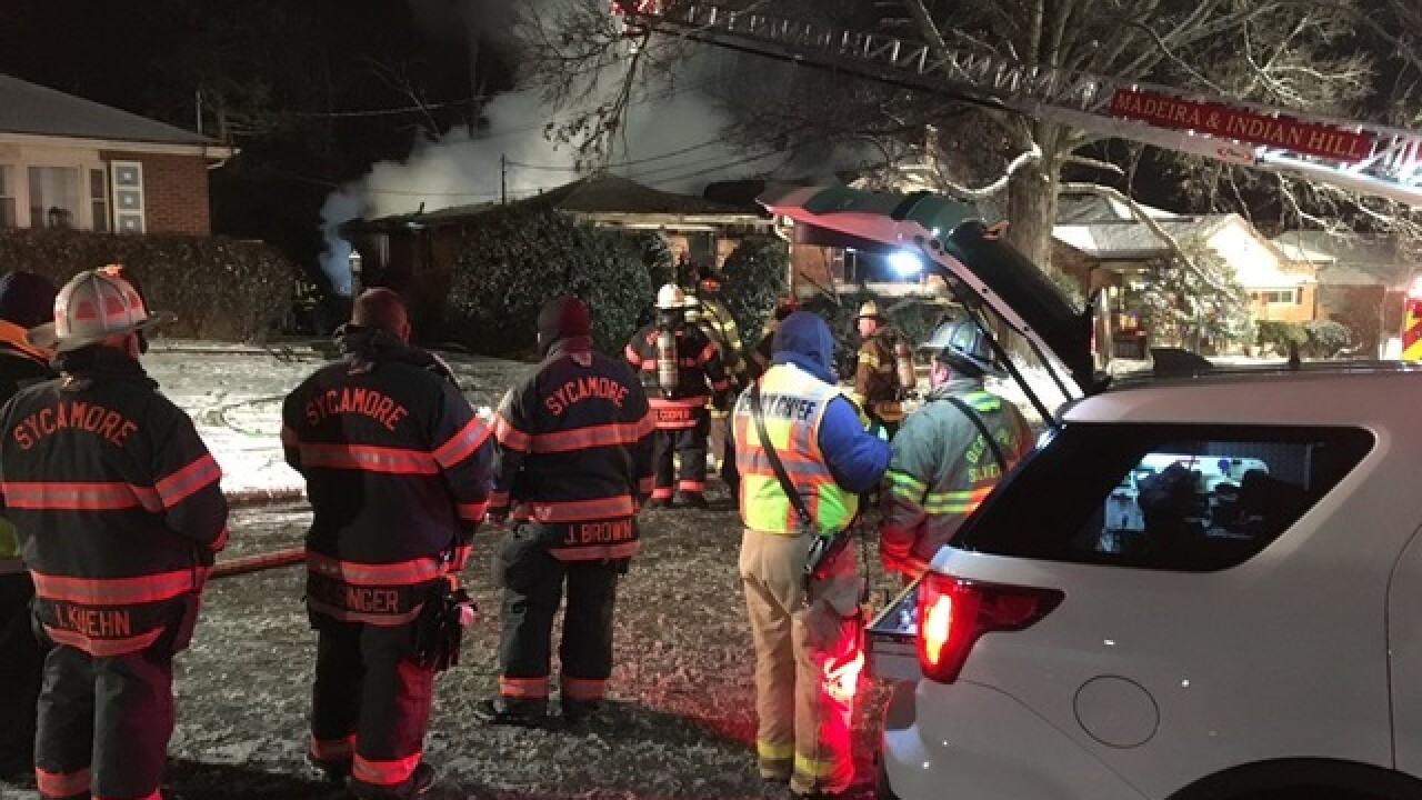 Man's body found in basement of burning home