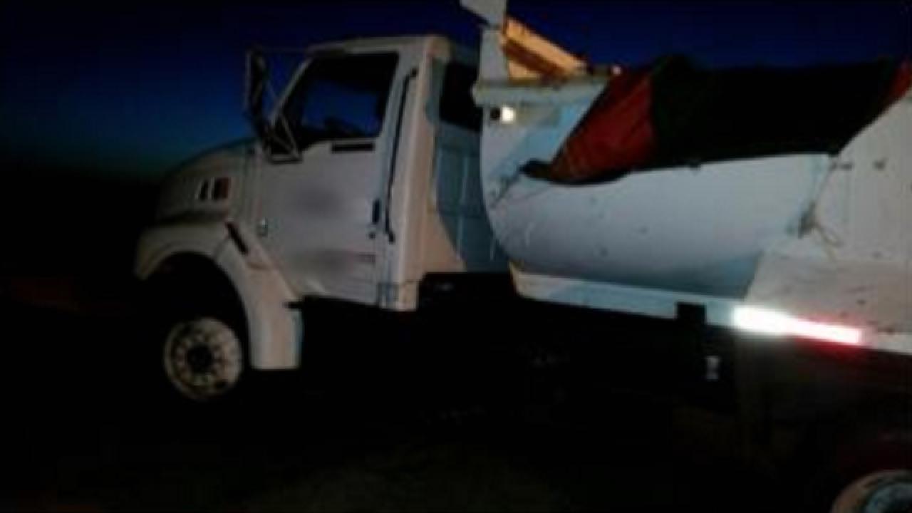 CBP arrests 14 hiding in dump truck