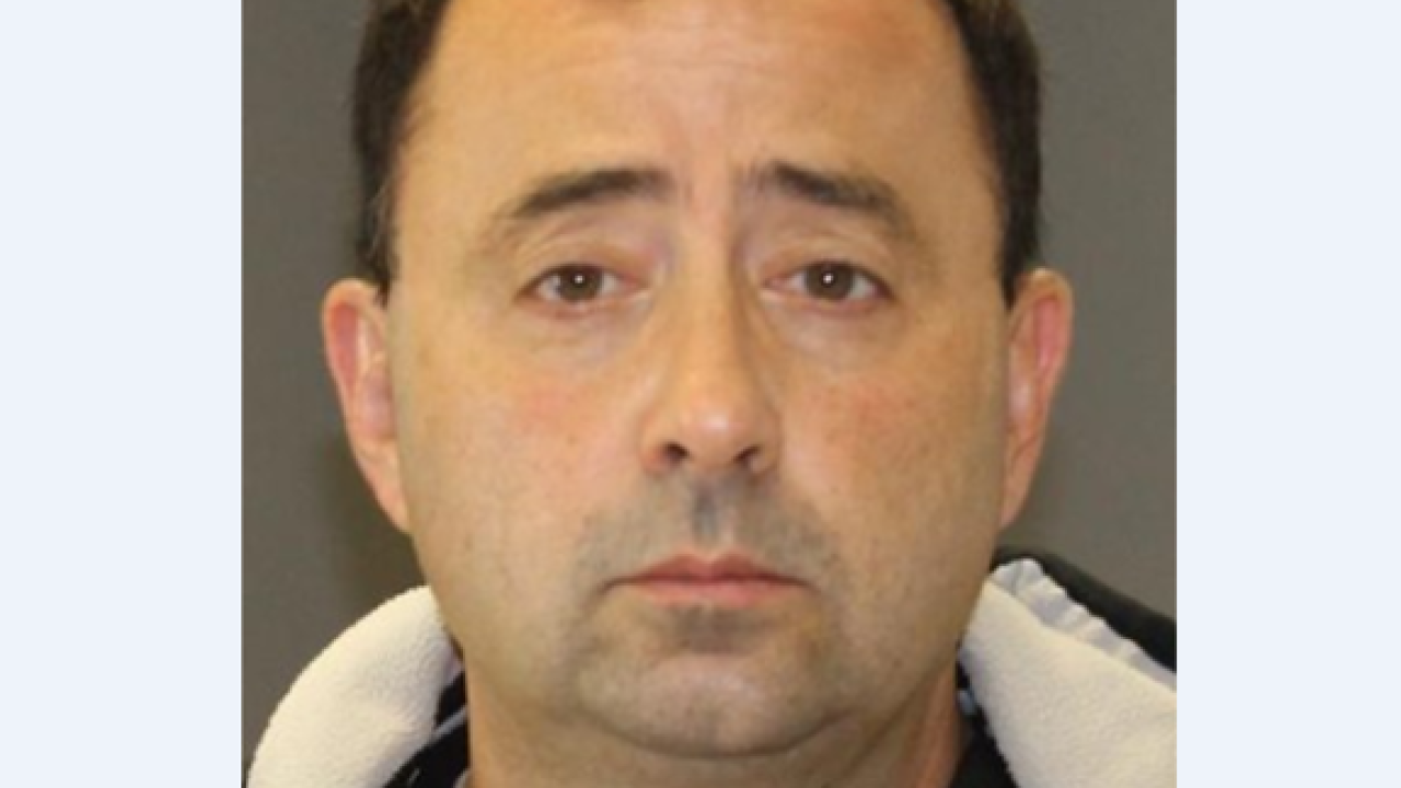 Gymnastics doctor charged with 22 counts in sex assault case