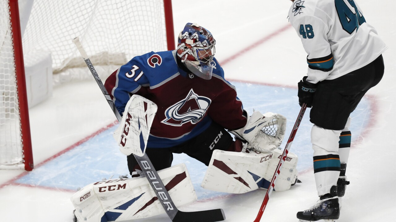 Grubauer has 27 saves, Avs blank Sharks, 4-0