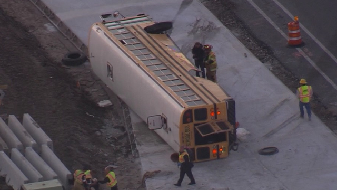 School bus overturns following crash, 6 injured