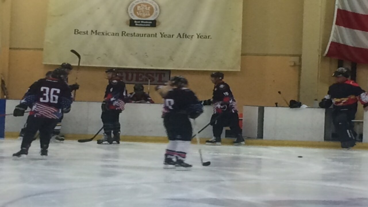Police, firefighters face off in hockey game