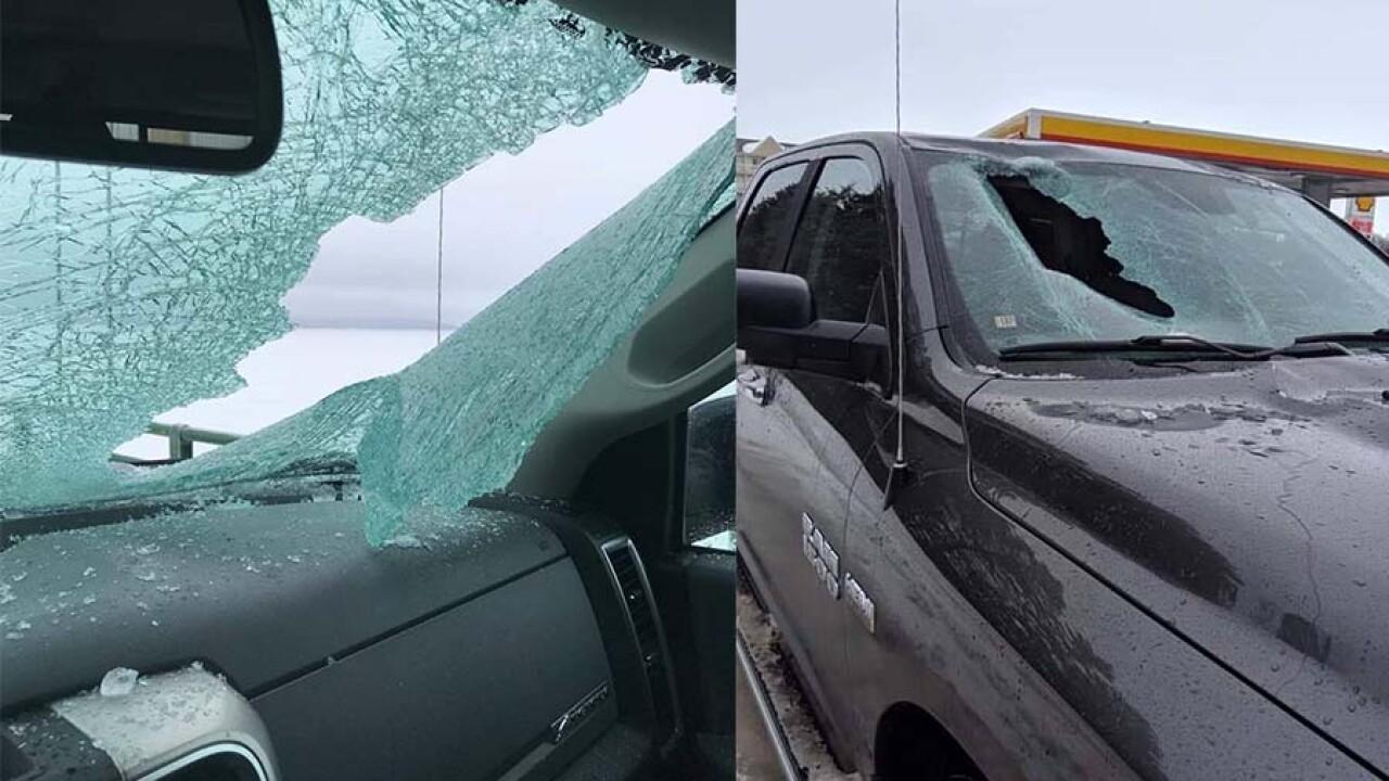 ice falls from mackinac bridge, shatters window of pickup truck