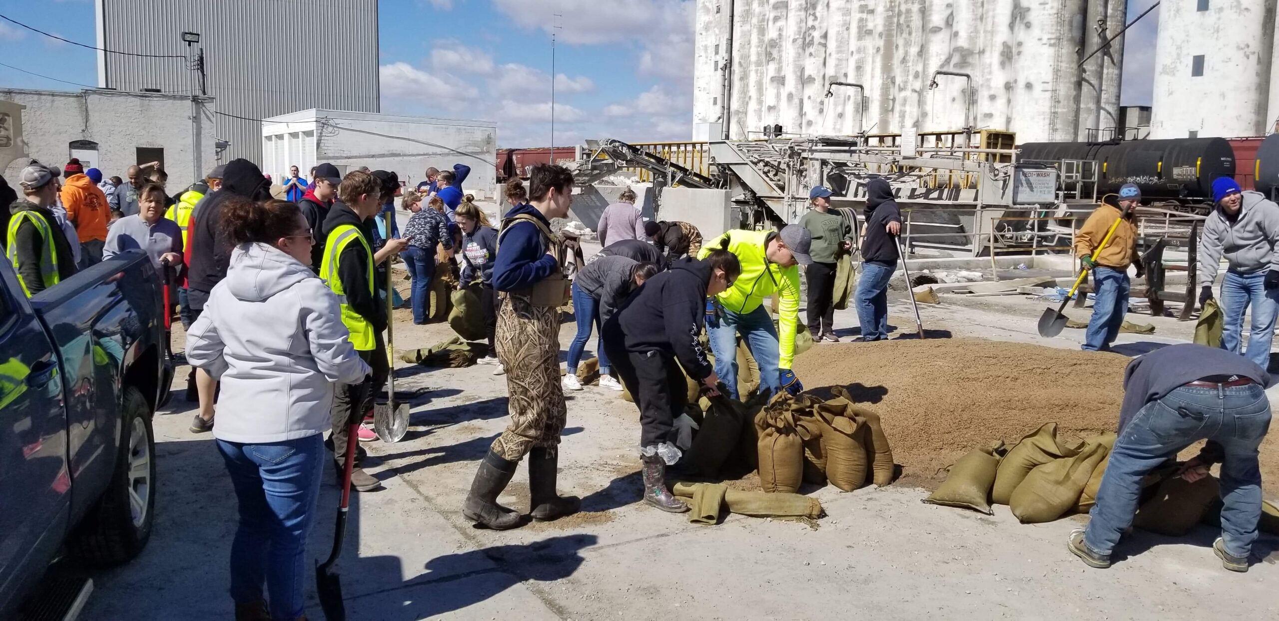 Fremont Flood Volunteers - Sandbags Being Filled and Set Up as a Barrier