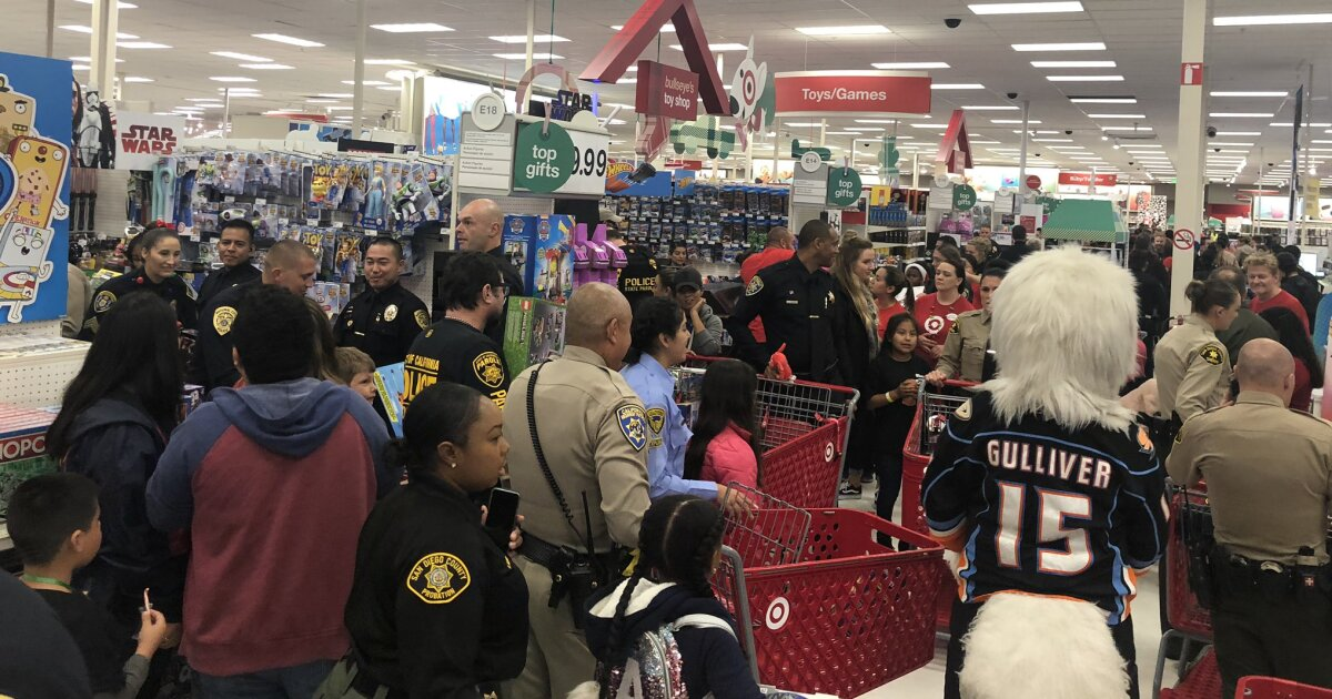 Kids get holiday wish during 'Shop with a Cop'
