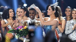 Miss Universe 2019 Zozibini Tunzi, of South Africa, is crowned onstage by Miss Universe 2018 Catriona Gray at the 2019 Miss Universe Pageant at Tyler Perry Studios on December 08, 2019 in Atlanta, Georgia.