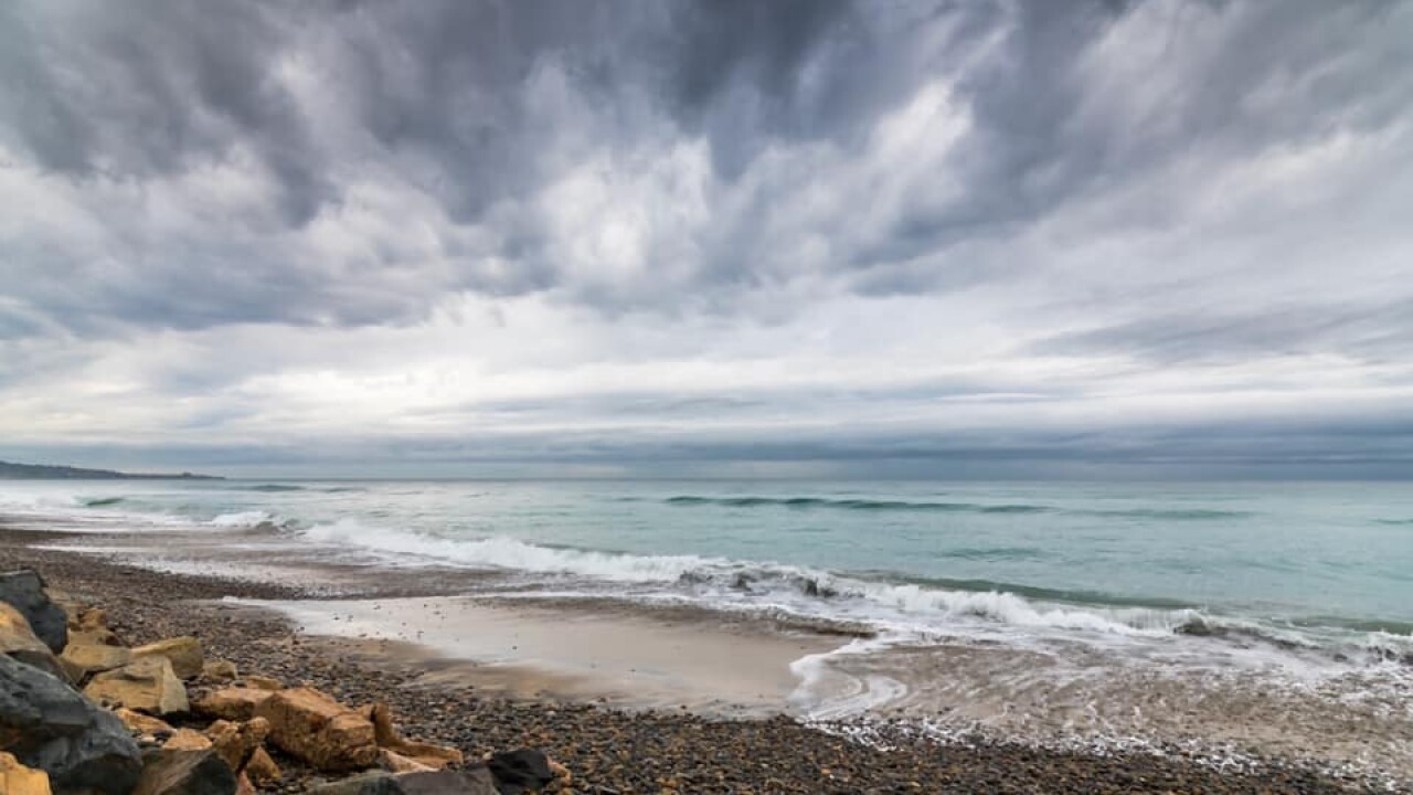 Storm clouds hover over Torrey Pines State Natural Reserve & State Beach