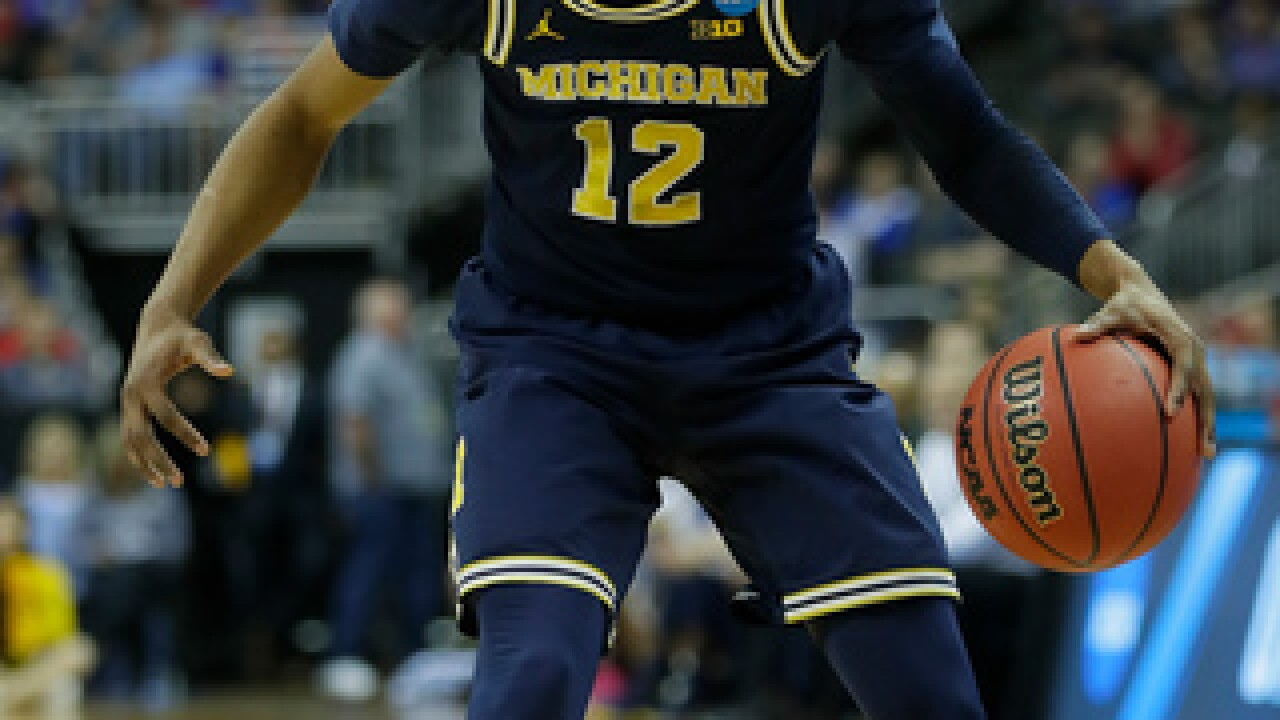 Abdur-Rahkman scores 17 in Michigan's 72-65 win over Chips
