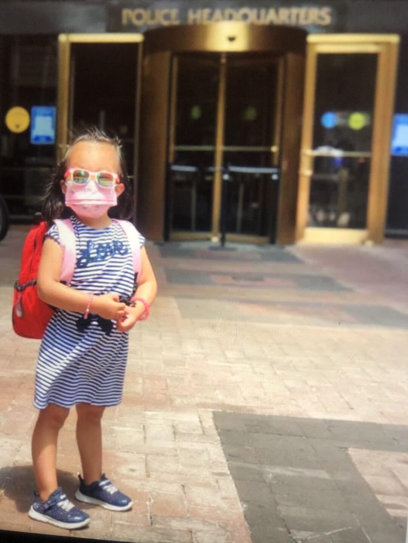 Angelina Liu with mask and backpack outside 1 Police Plaza