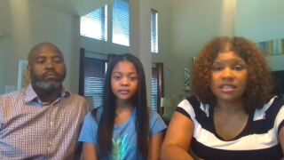 Shayla Johnson and parents.JPG
