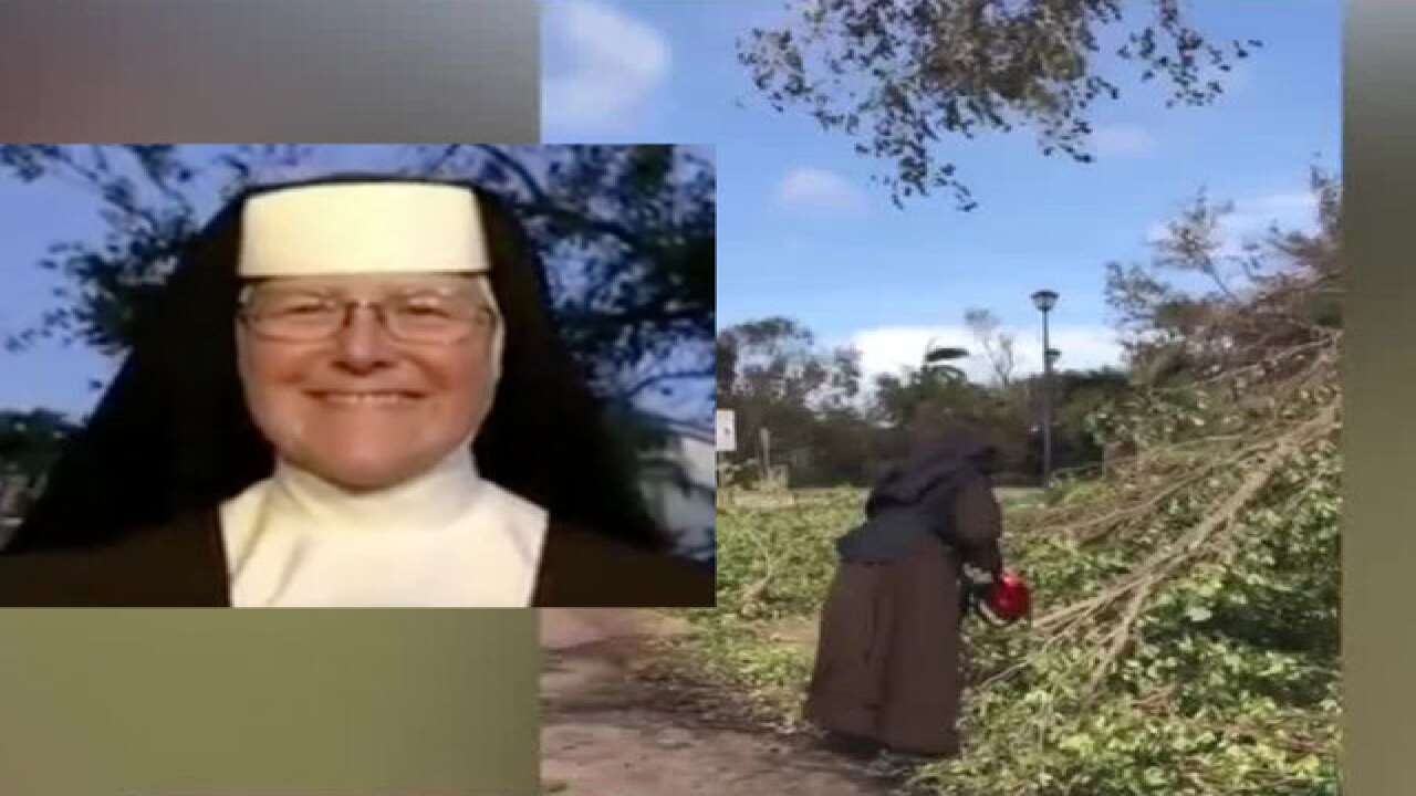 Nun with chainsaw helps with Irma cleanup