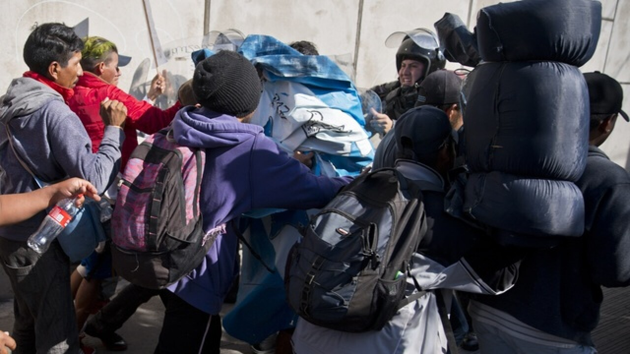 Migrants enveloped in tear gas at San Ysidro