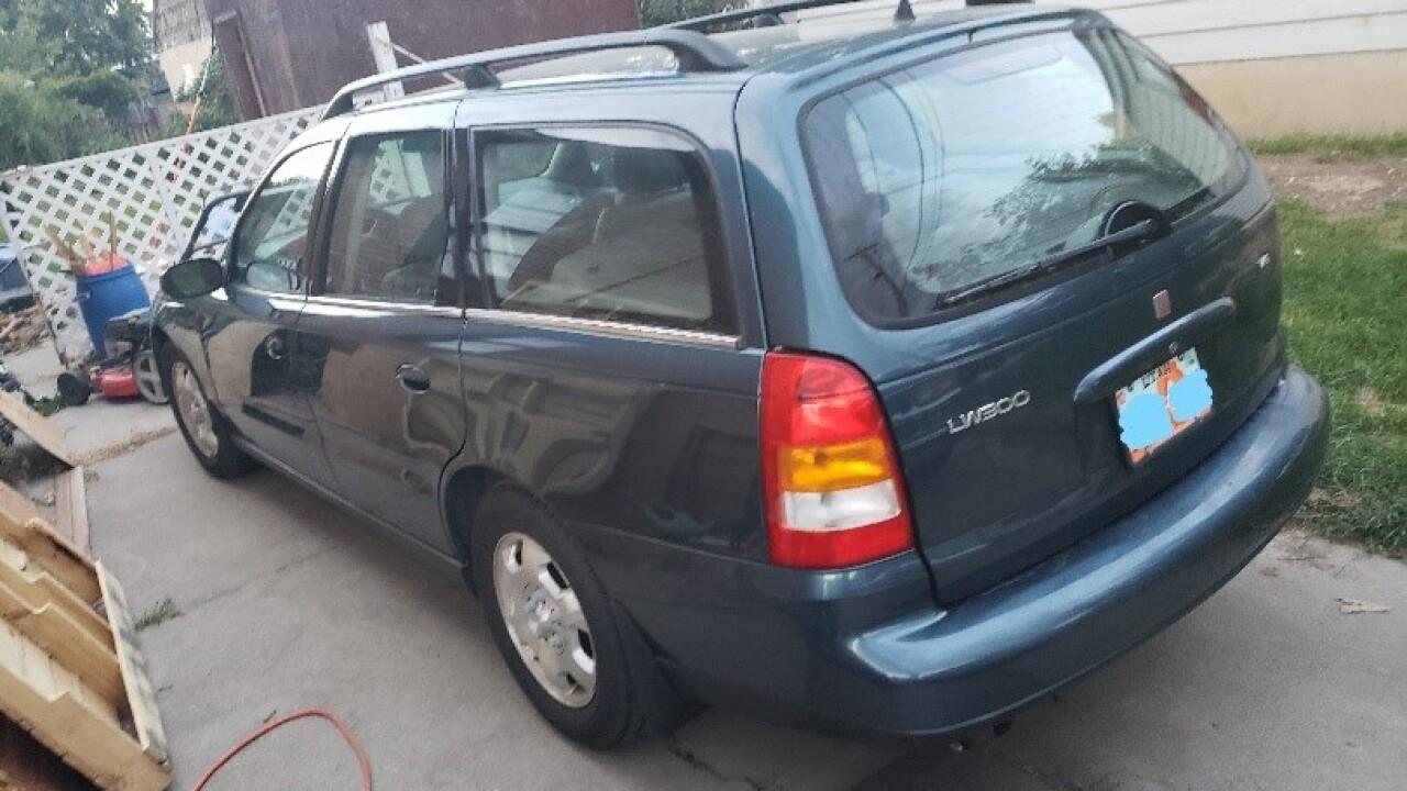 Blue 2002 Saturn LW300 station wagon with Utah license plate 51AR4