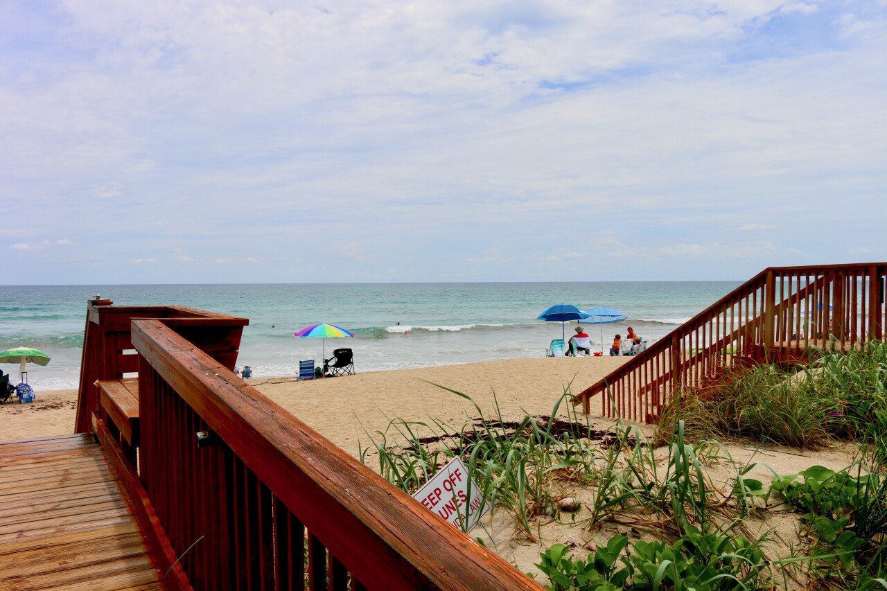 Stairs lead down to the Atlantic Ocean from Shuckers on the Beach.
