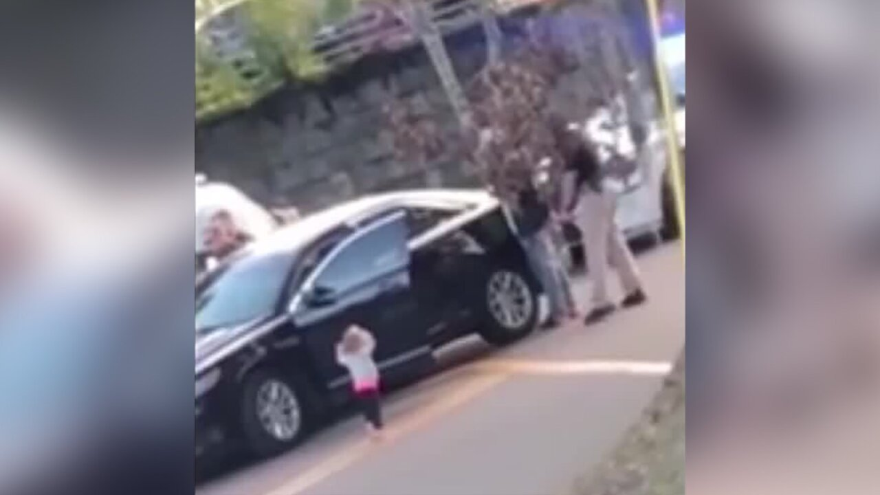 Toddler with hands up during traffic stop