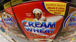 Image of Black chef being removed from Cream of Wheat packaging