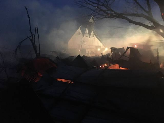 PHOTOS: Johnson County fire destroys multiple barns, kills 11 show pigs