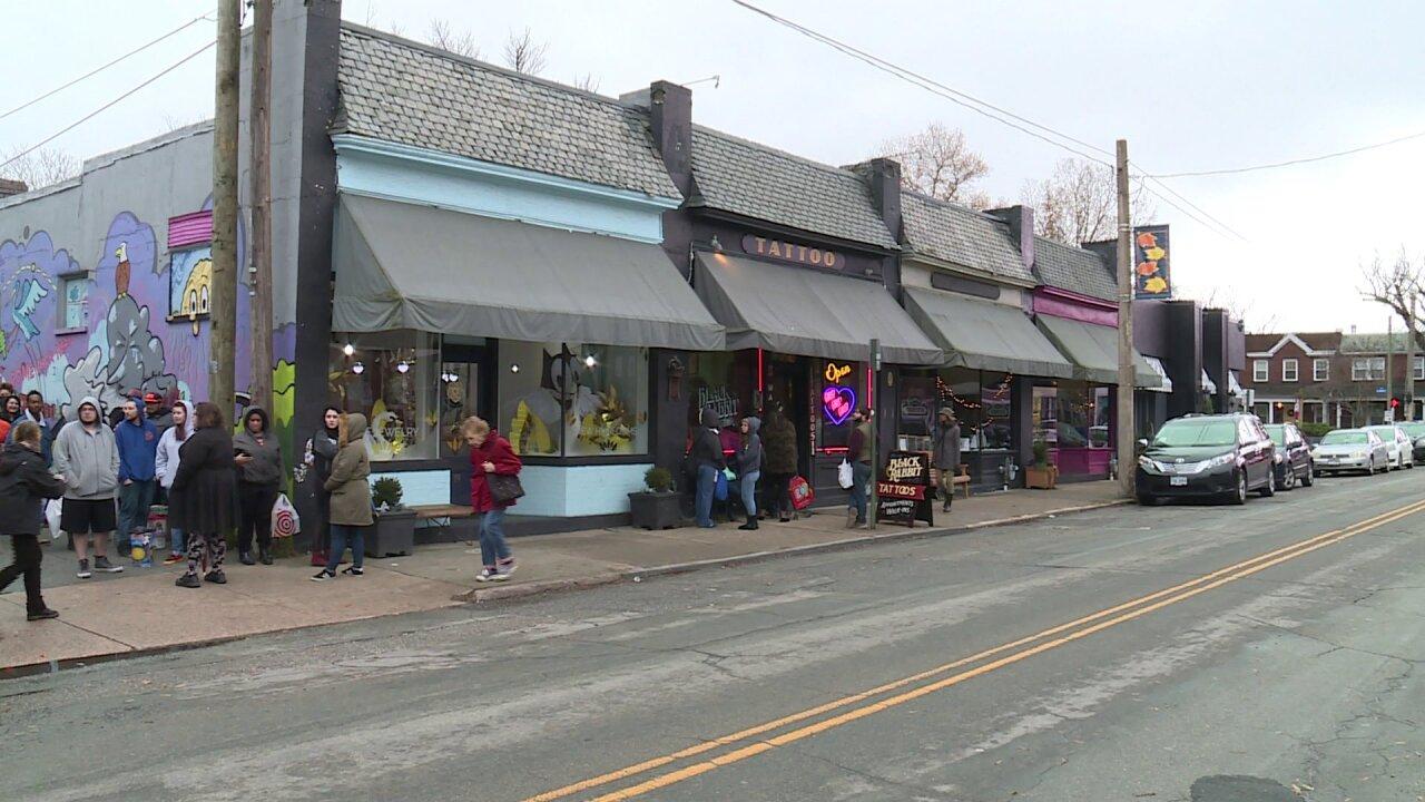 Dozens line up to trade toys for tattoos inRichmond