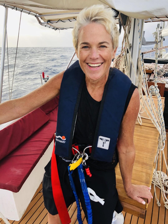 Marty Widrick smiles while wearing life jacket