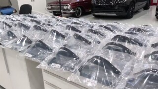 Avant-Garde Designs in Palm City works on high end cars, but now they are making thousands of face shields.