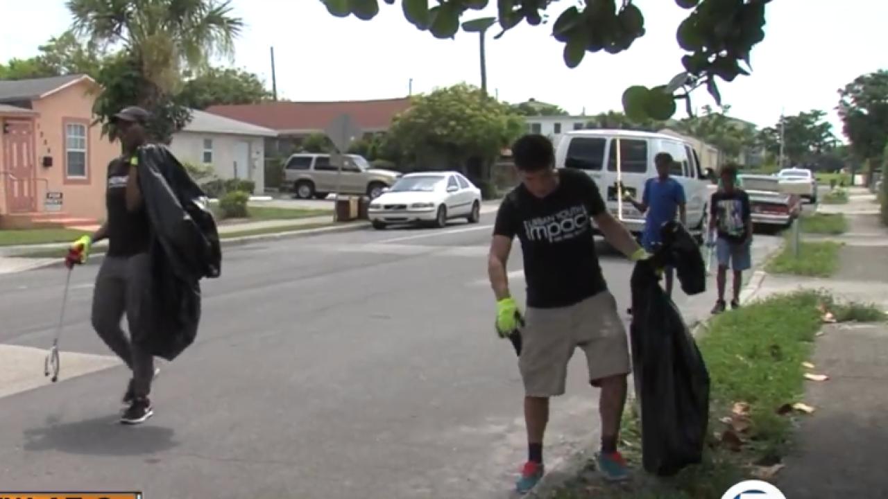 wptv kids picking up trash.PNG