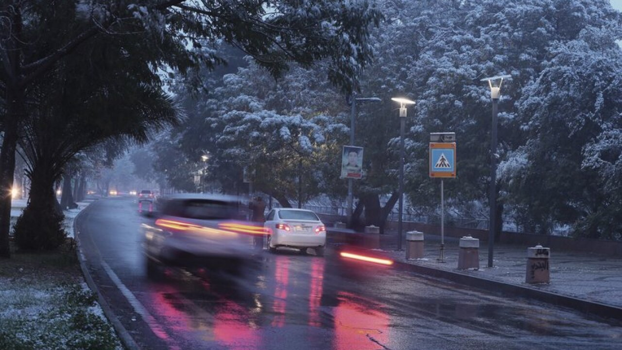 Iraqis wake up to snow for first time in over a decade