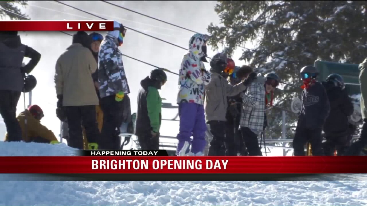 Skiers and snowboarders celebrate opening day at Brighton