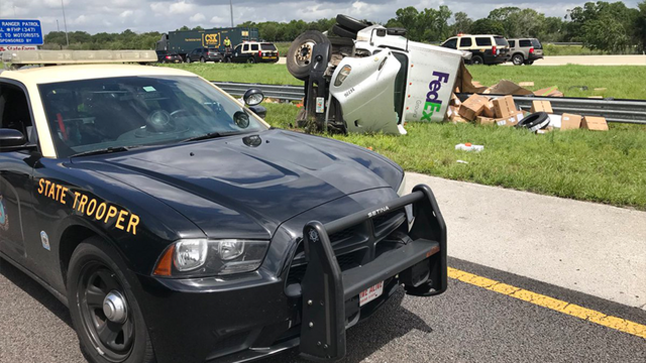 Driver dies after FedEx truck overturns, crashes into vehicle on I-4