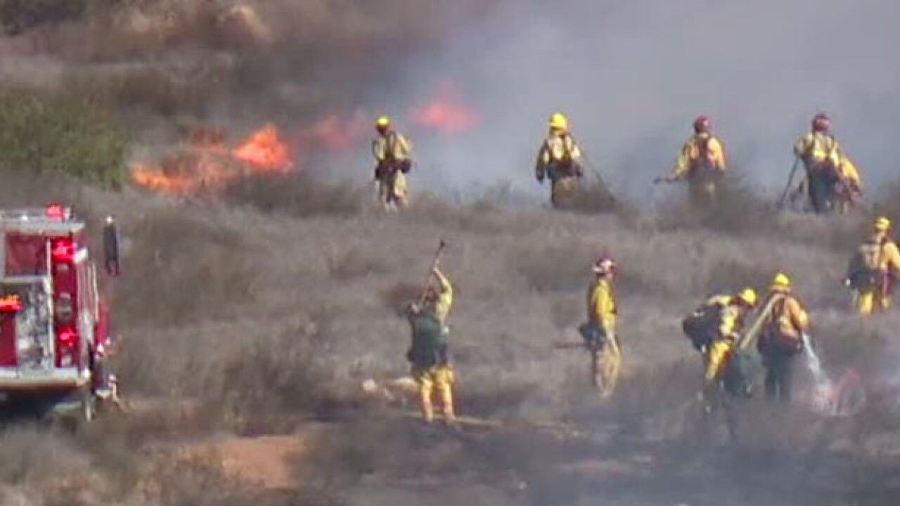 Brush fire erupts near homes on Agua Vista Drive in Chula Vista