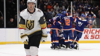 UNIONDALE, NEW YORK - DECEMBER 05: The New York Islanders celebrate the game winning overtime goal by Ryan Pulock #6 against the Vegas Golden Knights at NYCB Live's Nassau Coliseum on December 05, 2019 in Uniondale, New York. The Islanders defeated the Golden Knights 3-2 in overtime. (Photo by Bruce Bennett/Getty Images)