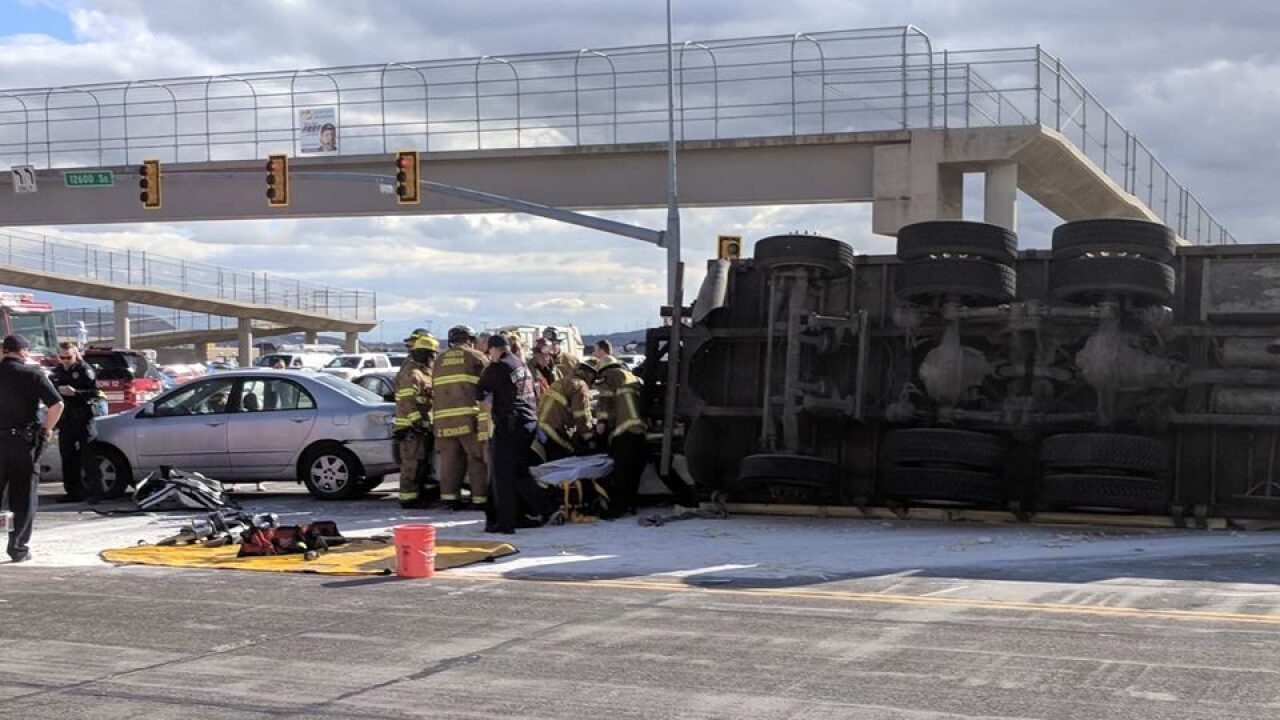 Semi-truck overturns on cars in Riverton; multiple people injured
