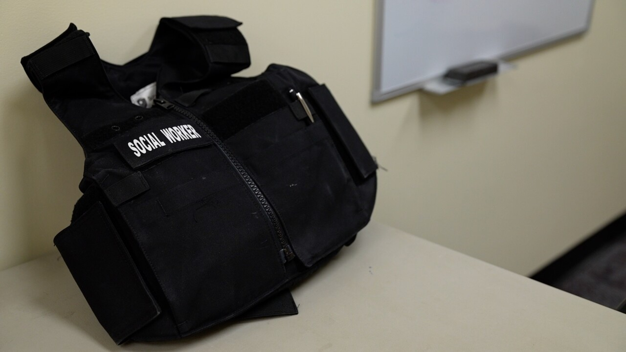 """Jan Bidwell's bulletproof vest with the words """"social worker"""" stitched on it"""