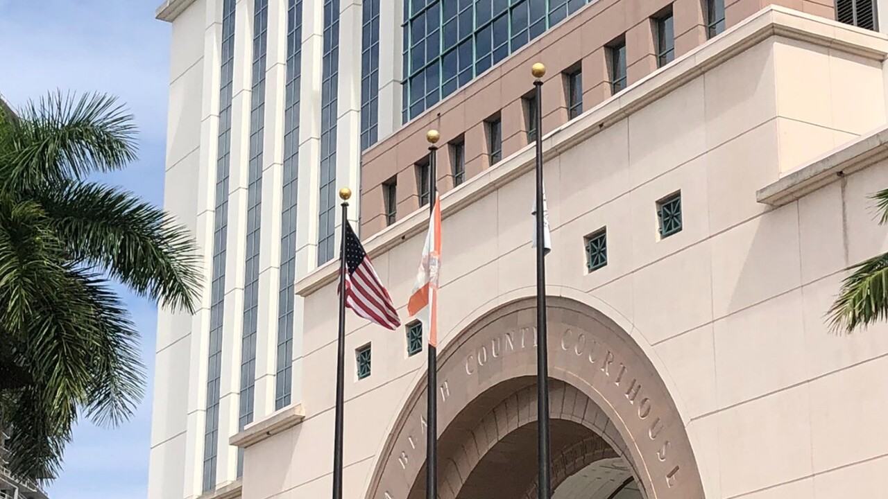 Flags outside the Palm Beach County Courthouse in downtown West Palm Beach on Feb. 24, 2021.jpg