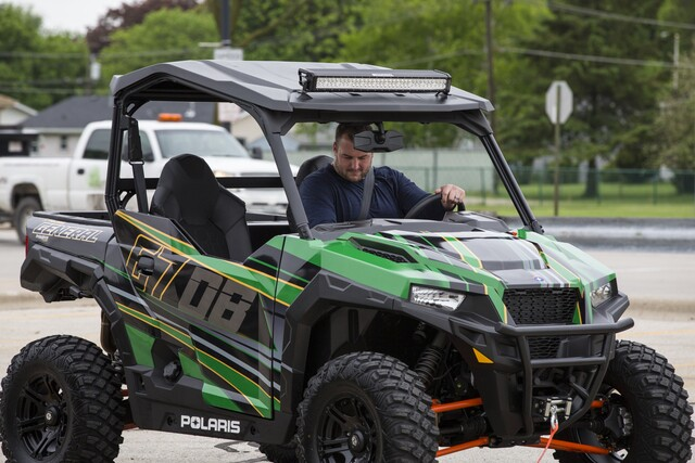 Aaron Rodgers gives the gift of Polaris ATVs to his
