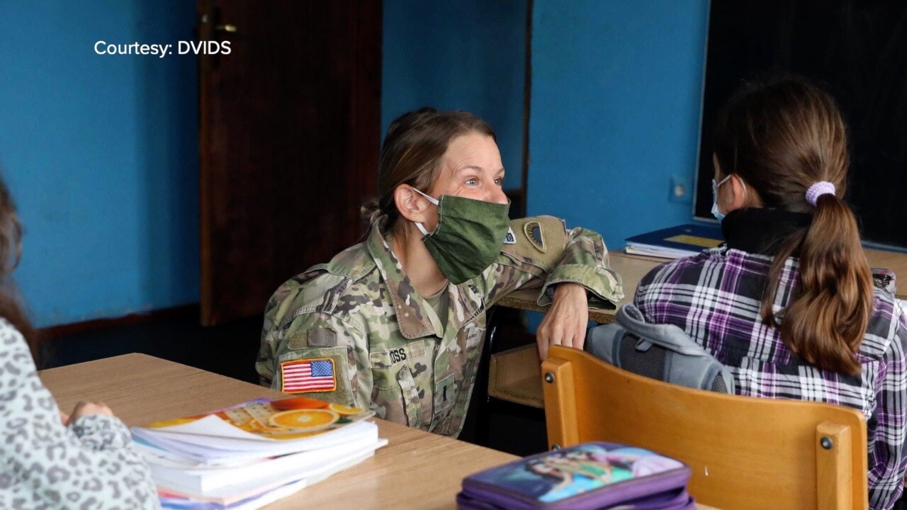 Soldiers help students in Kosovo.jpg