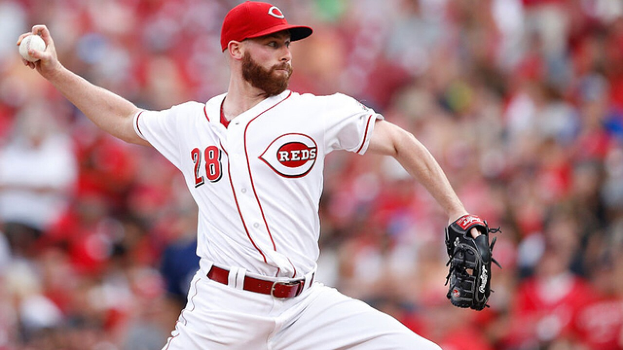 Doubles by Duvall, Barnhart rally Reds over Brewers 5-4