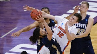 Oral Roberts Golden Eagles guard Kareem Thompson grabs rebound over Florida Gators forward Colin Castleton in 2021 NCAA tournament