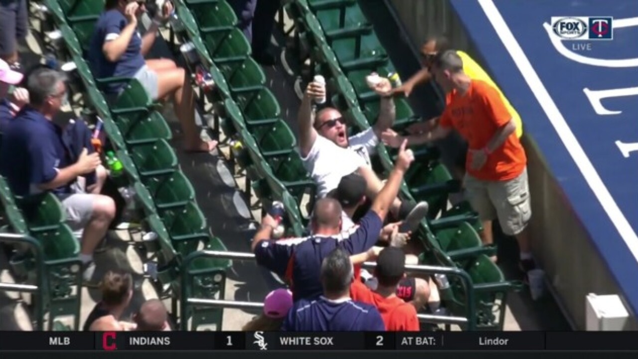 Watch this Detroit Tigers fan catch a foul ball with a beer in his hand