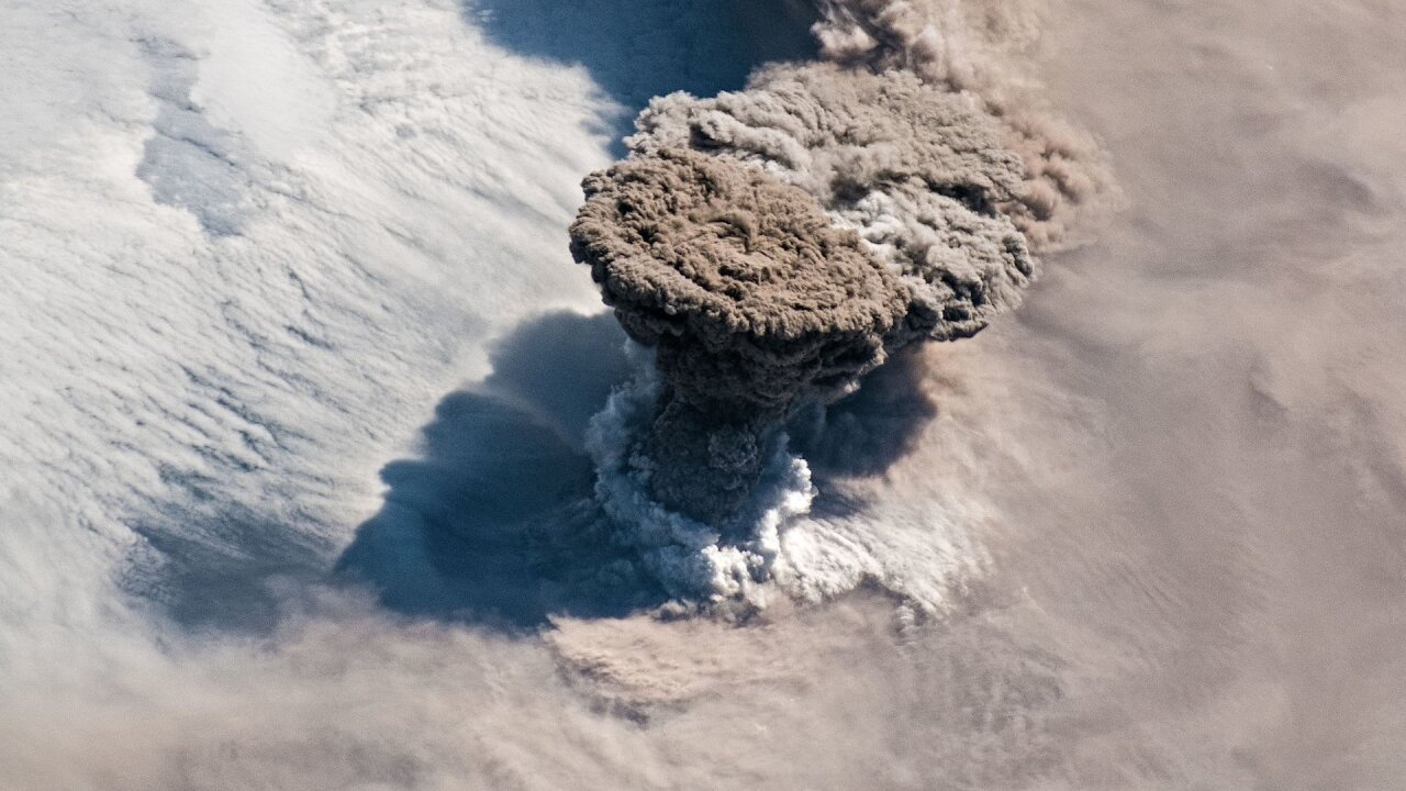 An erupting volcano is seen from space