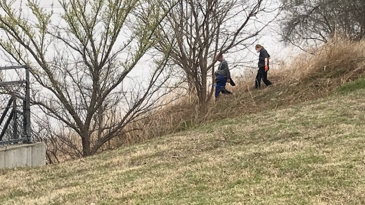 Tulsa Police Department Dive Unit going to retrieve a woman's body from the Arkansas River.