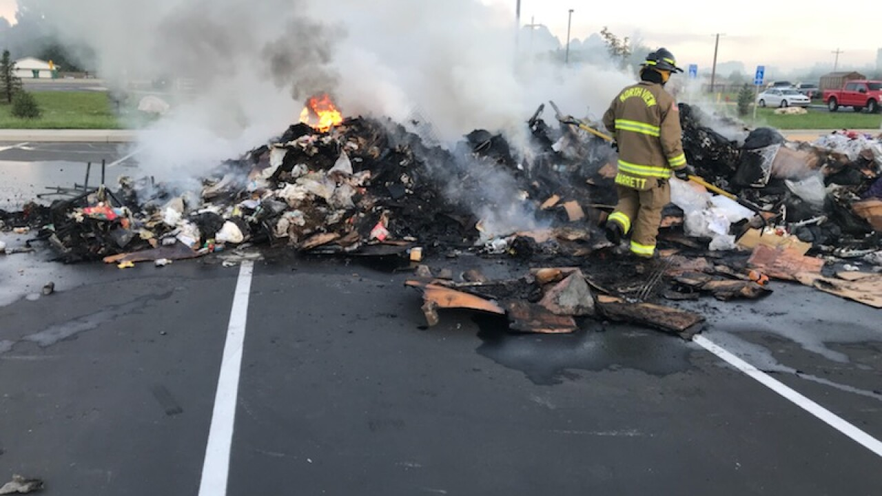 Charter school in Harrisville cancels classes after garbage truck driver dumps burning load in parking lot