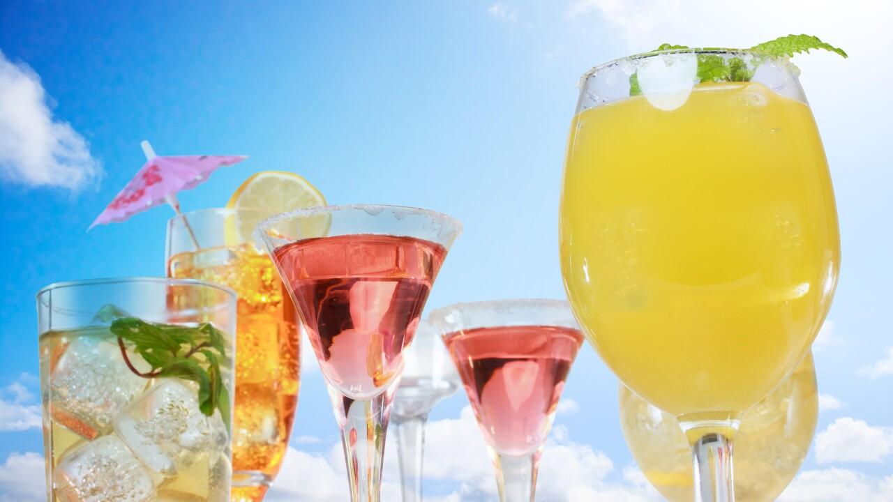 Assortment of drinks over blue sky