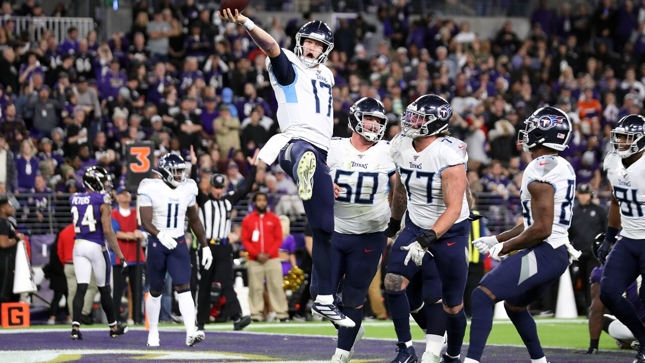 Titans' Henry makes history, defense makes big plays in 28-12 win ...