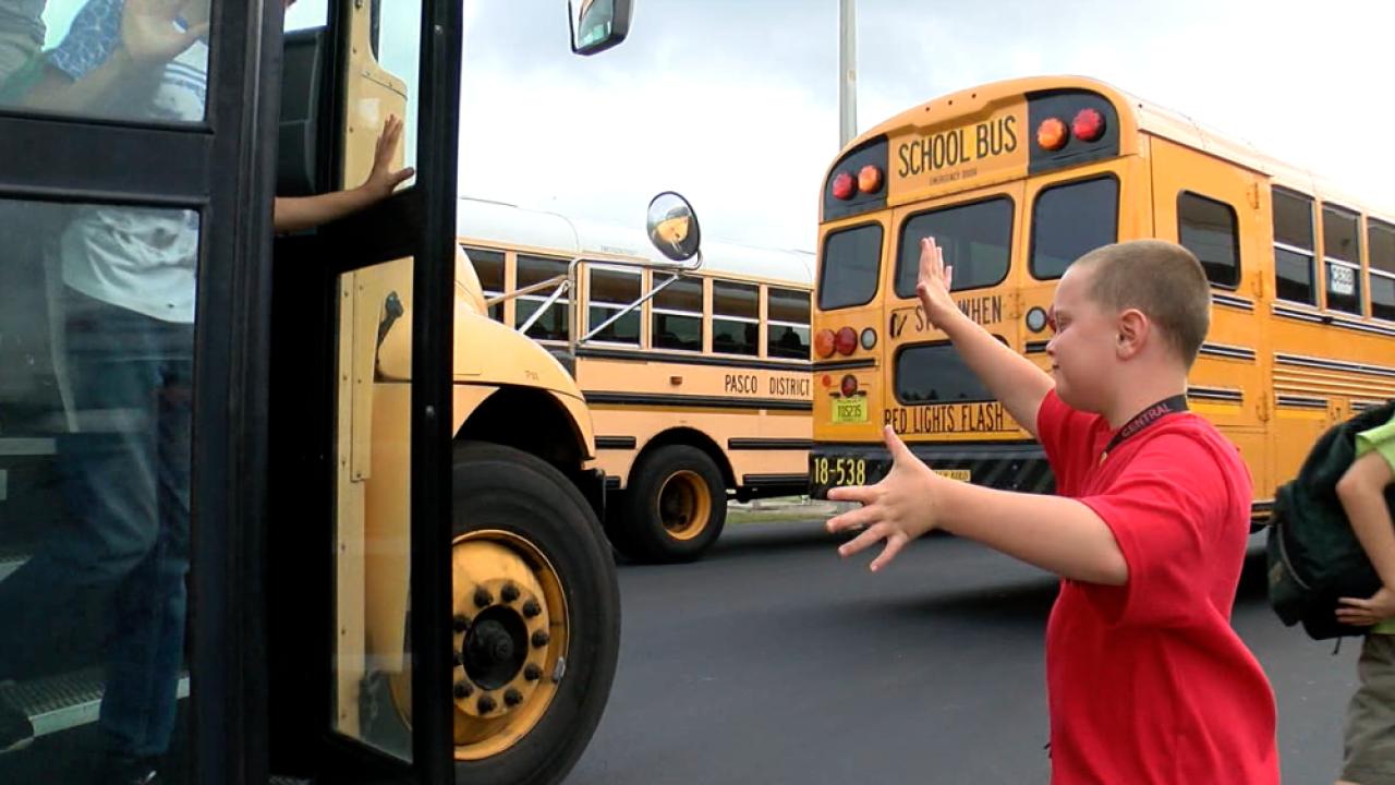 Levi White directing school buses
