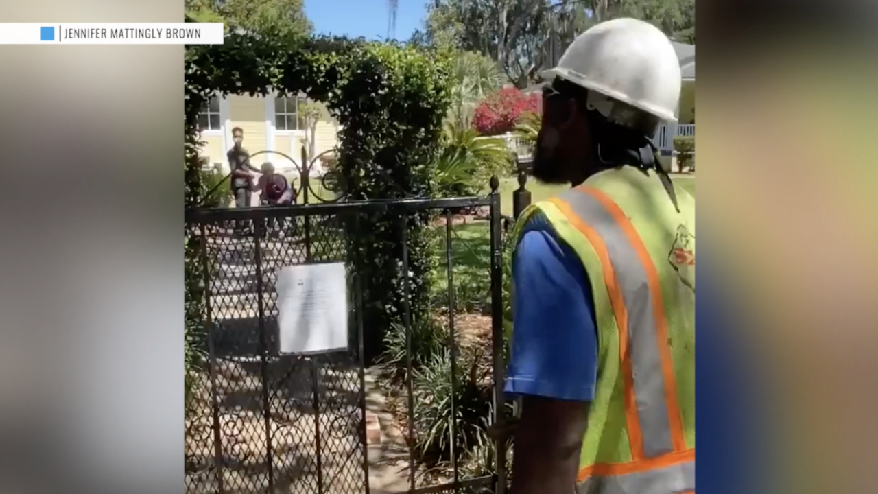 Utility worker sings hymn to brighten day of elderly woman at assisted living facility