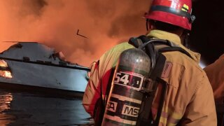US Coast Guard respond to boat fire; rescue efforts underway