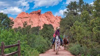 Horse Back Rides through Garden of the Gods by Larry Marr