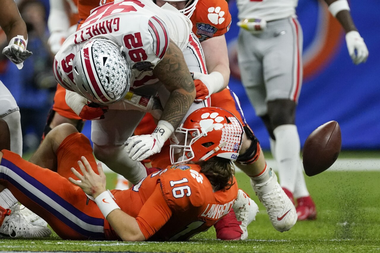 Ohio State Buckeyes defensive tackle Haskell Garrett forces Clemson Tigers QB Trevor Lawrence fumble in College Football Playoff at Sugar Bowl