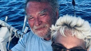Marty Widrick and Sven Karrlson smiling at sea